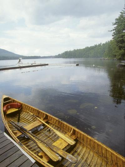 Canoe Floats Next to a Dock, Sebago Lake, Maine-Skip Brown-Photographic Print
