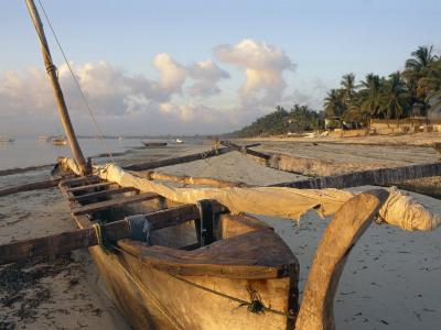 Canoe Pulled up onto Beach at Dusk, Bamburi Beach, Near Mombasa, Kenya, Africa-Charles Bowman-Photographic Print