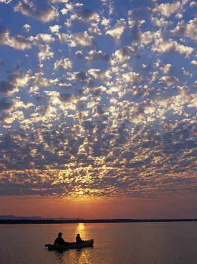 Canoeing under a Mackerel Sky at Dawn on the Zambezi River, Zambia-John Warburton-lee-Photographic Print