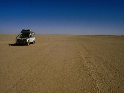 Car Crossing Sahara Desert, Algeria-Peter Ptschelinzew-Photographic Print