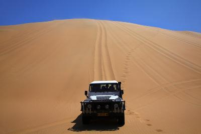Car Descending a Sand Dune, Namib-Naukluft National Park, Namibia-David Wall-Photographic Print
