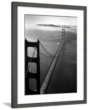 Car Lanes across the Golden Gate Bridge with Fog-Covered City of San Francisco in Background-Margaret Bourke-White-Framed Premium Photographic Print