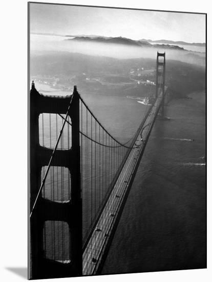 Car Lanes across the Golden Gate Bridge with Fog-Covered City of San Francisco in Background-Margaret Bourke-White-Mounted Premium Photographic Print