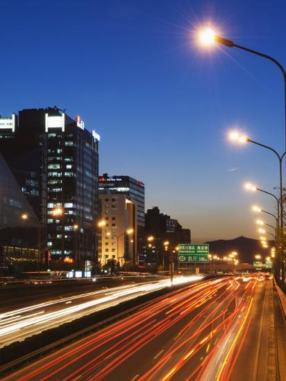 Car Light Trails and Modern Architecture on a City Ring Road, Beijing, China-Kober Christian-Photographic Print