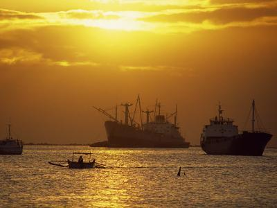 Cargo Ships and Outrigger Canoe in Manila Bay at Sunset, in the Philippines, Southeast Asia-Robert Francis-Photographic Print