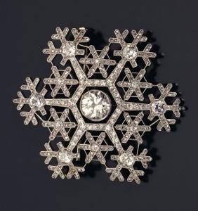 A Diamond and Platinum-Mounted Snowflake Brooch, circa 1908-1913 by Carl Faberge