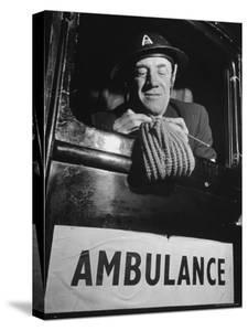 Ambulance Driver Knitting For the English Army During WWII by Carl Mydans