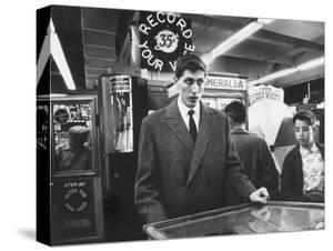 American Chess Champion Robert J. Fischer Playing Pinball by Carl Mydans