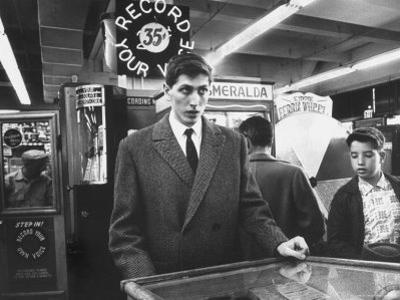 American Chess Champion Robert J. Fischer Playing Pinball