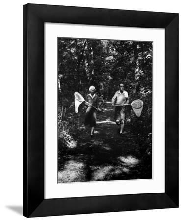 Author Vladimir Nabokov and His Wife Vera Chasing Butterflies