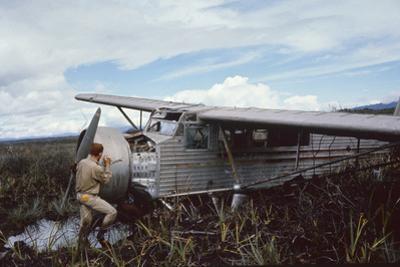 Aviator Roland Angel Repaints His Father's Flamingo Monoplane, Auyantepui, Venezuela, 1965