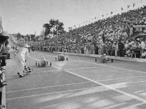 Boys and their Cars Crossing the Finish Line During the Soap Box Derby by Carl Mydans