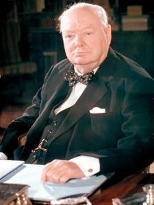British Politican Sir Winston Churchill, Formal Portrait at Desk by Carl Mydans