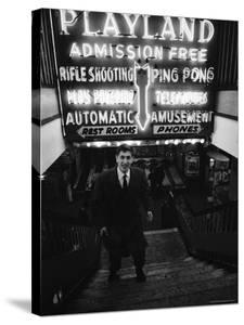 Chess Champion Bobby Fischer at the Entrance to a Playland Arcade by Carl Mydans