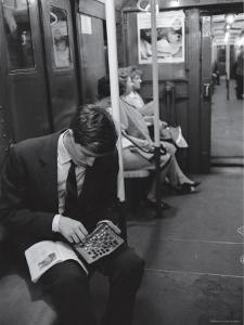 Chess Champion Bobby Fischer Working on His Moves During a Subway Ride by Carl Mydans