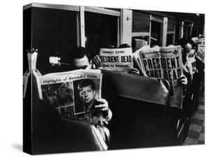 Commuters Reading of John F. Kennedy's Assassination by Carl Mydans