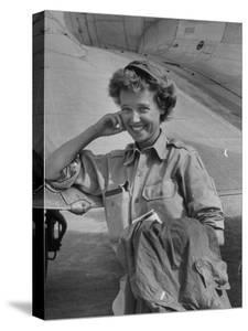 Correspondent Marguerite Higgins Smiling, Leaning Against Airplane by Carl Mydans