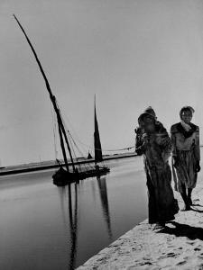 Egyptian Feluccas, Large Sailboats with Two Immensely Tall Masts, Pulled up Canal by Natives by Carl Mydans