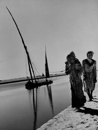 Egyptian Feluccas, Large Sailboats with Two Immensely Tall Masts, Pulled up Canal by Natives