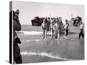 Generals MacArthur and Sutherland and Colonel Lehrbas Wading Ashore at Lingayen Gulf by Carl Mydans