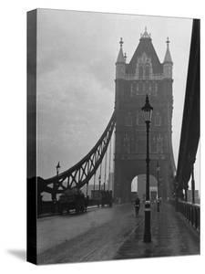 Light Traffic across Tower Bridge on an Overcast Day by Carl Mydans