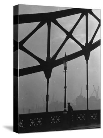 London Bobby in His Wartime Tin Helmet Patrolling the Tower Bridge