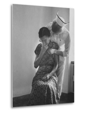 Nurse Trying to Comfort an Elderly Patient