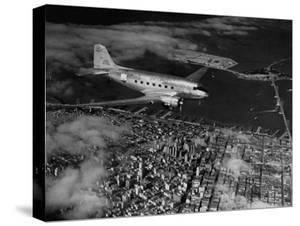Plane Flying over a City from a Story Concerning United Airlines by Carl Mydans