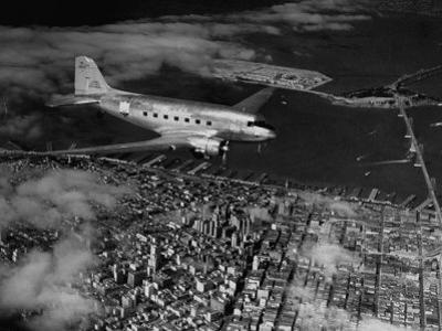 Plane Flying over a City from a Story Concerning United Airlines