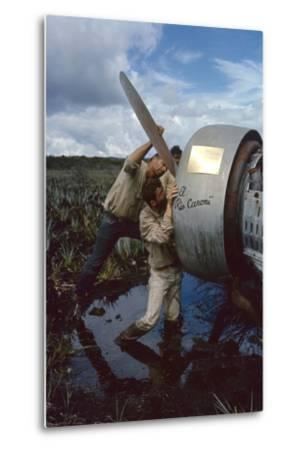 Roland Angel and Allen Waller Working on Angel's Father's Monoplane, Auyantepui, Venezuela, 1965