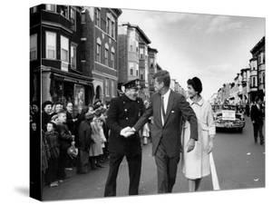Sen. Jack Kennedy with Jackie, Walking Down Middle of the Street During Senate Re-Election Campaign by Carl Mydans