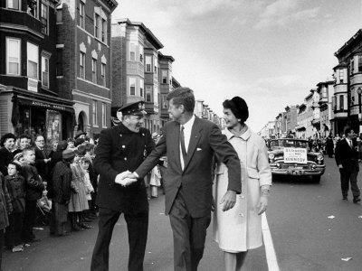 Sen. Jack Kennedy with Jackie, Walking Down Middle of the Street During Senate Re-Election Campaign