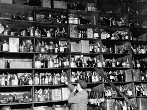 Shelves of Illegal Liquor Stored in the Nypd Property Clerks Office by Carl Mydans