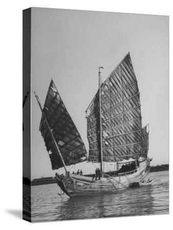 Side View of Junk with Tattered Sails in Whangpoo River