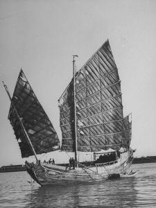 Side View of Junk with Tattered Sails in Whangpoo River by Carl Mydans