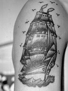 Tattoo of a Ship Being Displayed on Arm of a Us Sailor by Carl Mydans