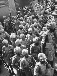 The Indian Sikh Troops from Punjab, Boarding the Troop Transport in the Penang Harbor by Carl Mydans