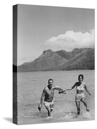 Two People on the Beach in Paradise Island, Tahiti