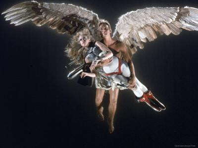 """Actress Jane Fonda Being Carried by Guardian Angel in a Scene from Roger Vadim's Film """"Barbarella"""""""