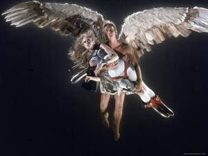 """Actress Jane Fonda Being Carried by Guardian Angel in a Scene from Roger Vadim's Film """"Barbarella"""" by Carlo Bavagnoli"""