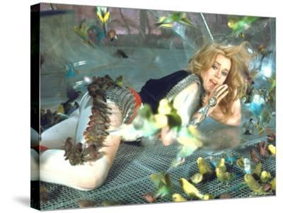 """Jane Fonda is Preyed Upon by Parakeets and Finches in Scene from Roger Vadim's """"Barbarella"""""""