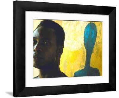 Portrait of Nigerian Artist Erhabor Emokpae Standing Next to One of His Colorful Paintings