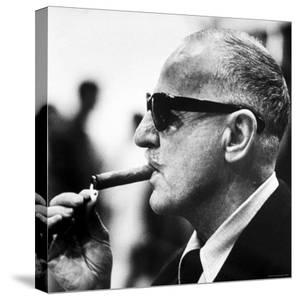 "Producer Darryl F. Zanuck Lighting Cigar on the Set of Film ""Rapture"" by Carlo Bavagnoli"