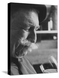 Wine Taster Sniffing Wine Before Tasting It by Carlo Bavagnoli