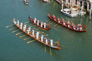 The boats of the historical procession for the historical Regatta on the Grand Canal of Venice by Carlo Morucchio