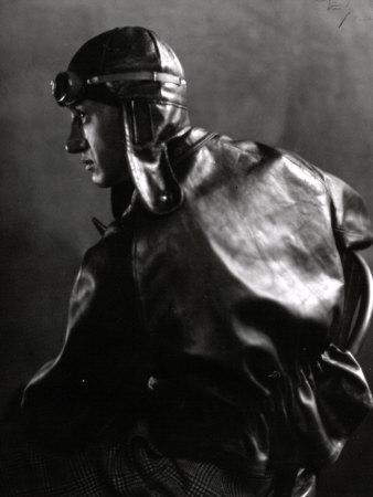 Half-Length Portrait in Profile of a Motor Cyclist with Leather Jacket and Helmet