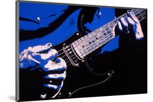 Close-up of Electric Guitar Player by Carol & Mike Werner