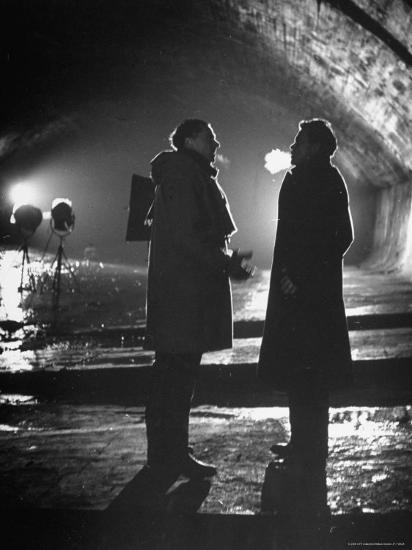 """Carol Reed Coaching Orson Welles as They Stand Against Floodlights During Filming """"The Third Man.""""-William Sumits-Premium Photographic Print"""