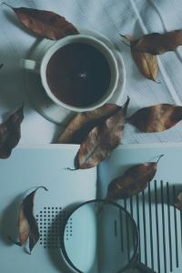 Brown Leaves and a Cup of Coffee by Carolina Hernandez