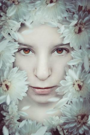 Close Up of Young Girls Face in Flowers